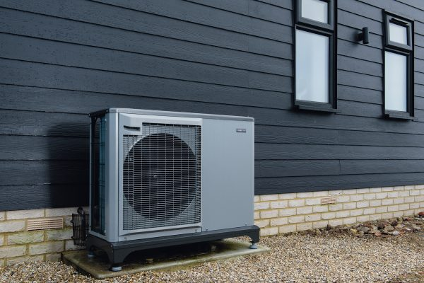 a heat pump placed outside of the house